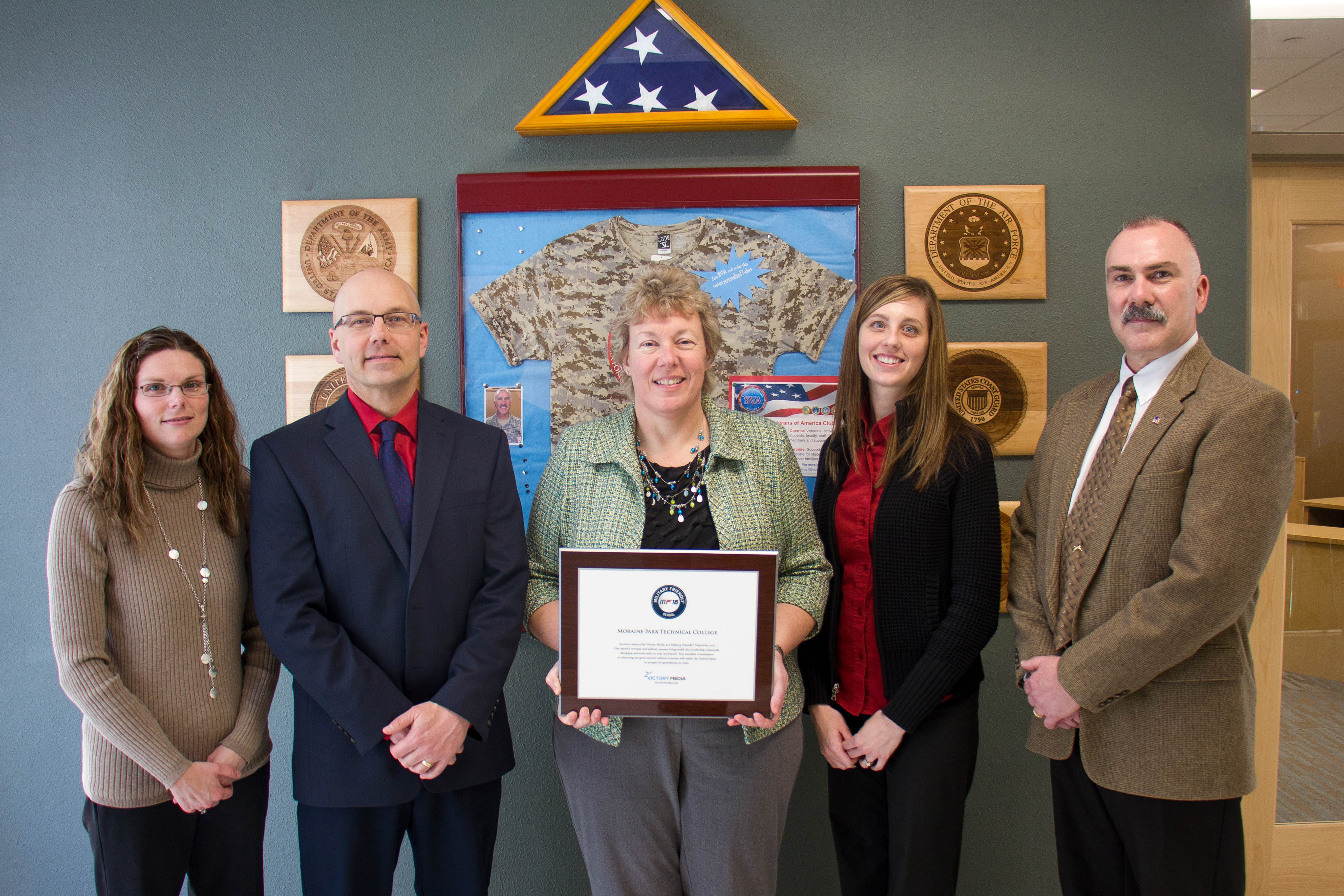 Moraine Park president Bonnie Baerwald holding Military Friendly award with Kim DeMaa, Steve Pepper, Stephanie Lueck, and Scott Pieper