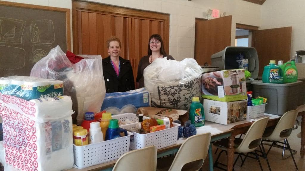 MPACTE members with household supply donations to Solutions Center