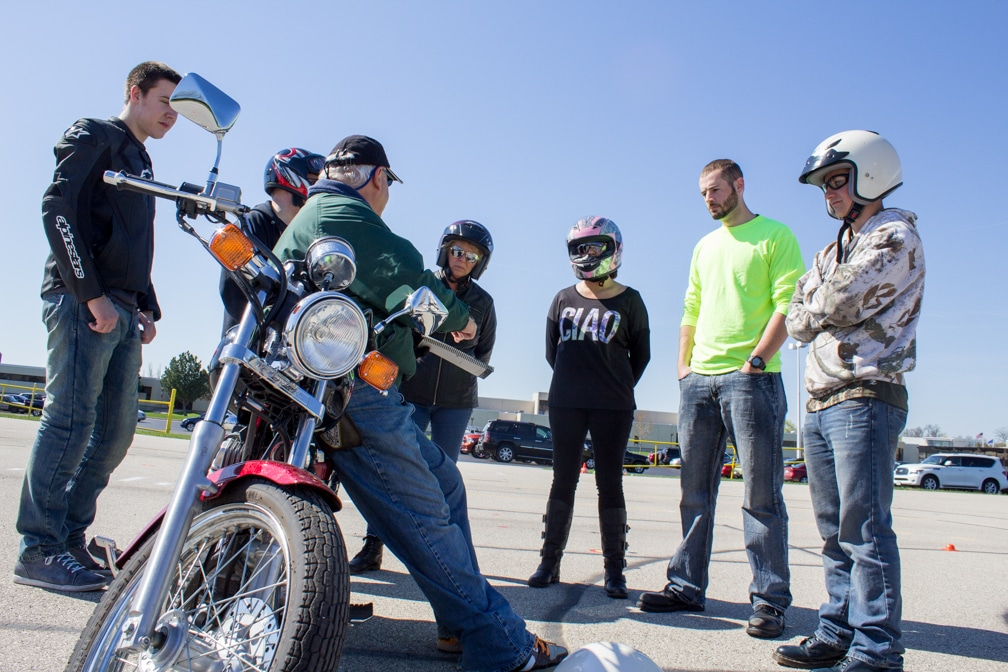Six motorcycle safety students with instructor that is leaning on motorcycle at Moraine Park