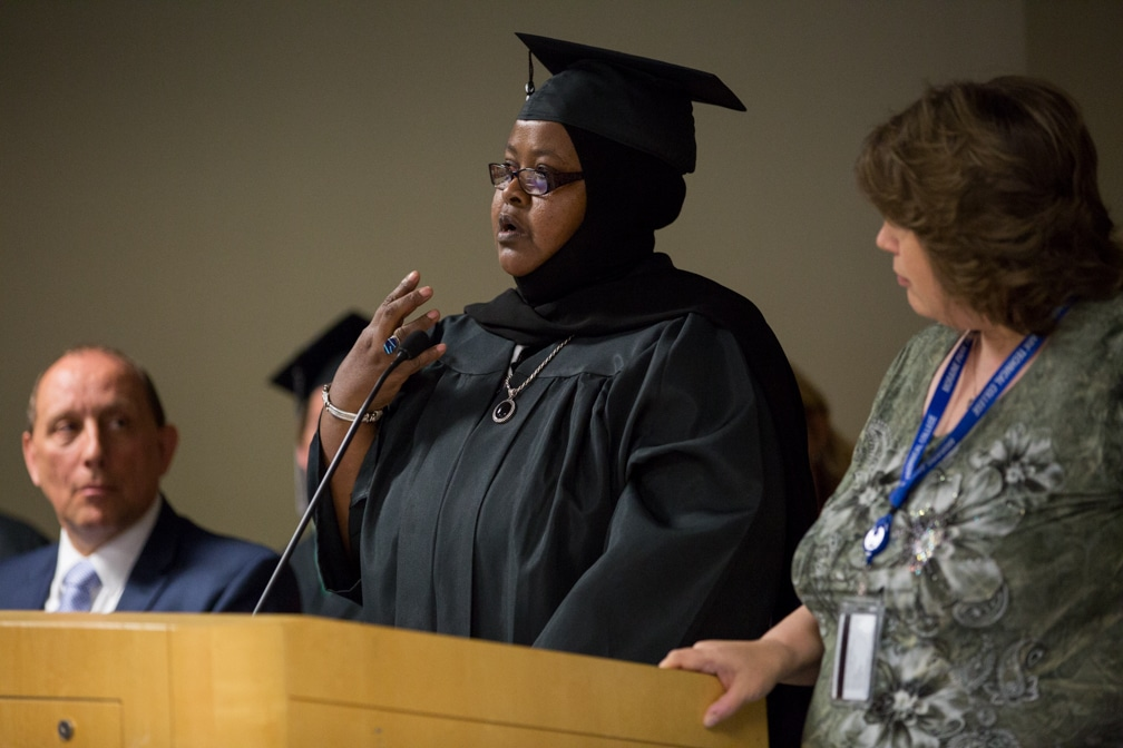 Ambiyo Munie gives speech from podium during Moraine Park GED-HSED graduation ceremony