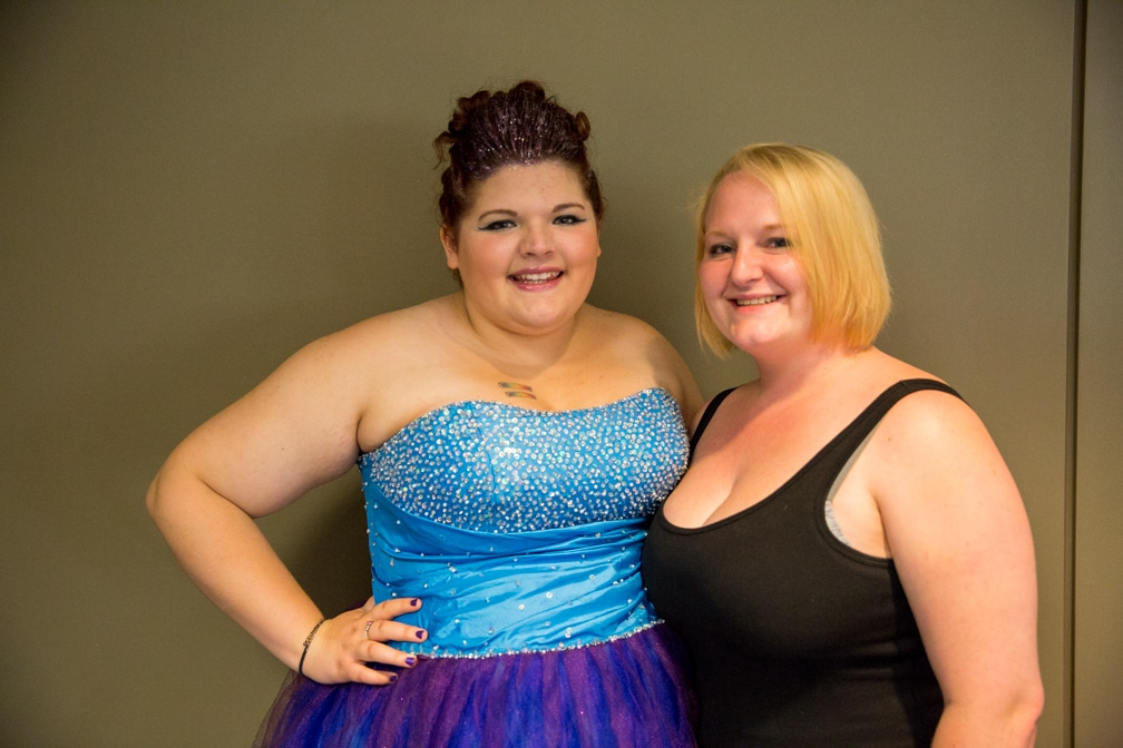 Two females all dressed up for the Moraine Park Technical College Cosmetology Fashion Show
