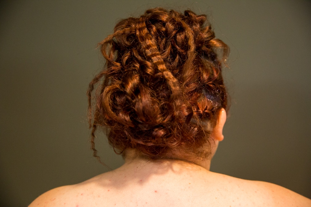 Female showing the back of her updo for the Moraine Park Technical College Cosmetology Fashion Show