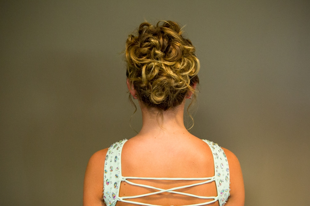 Female showing her updo for the Moraine Park Technical College Cosmetology Fashion Show