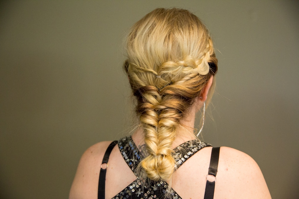 Female showing the back of her hairstyle braid for the Moraine Park Technical College Cosmetology Fashion Show