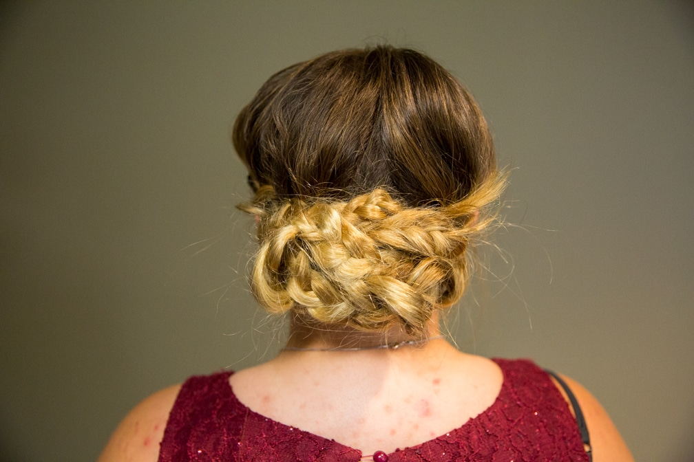 Female showing her hairstyle for the Moraine Park Technical College Cosmetology Fashion Show