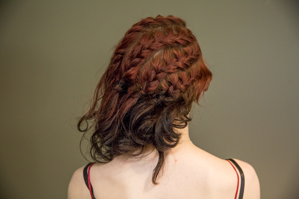 Female showing her braided hairstyle for the Moraine Park Technical College Cosmetology Fashion Show