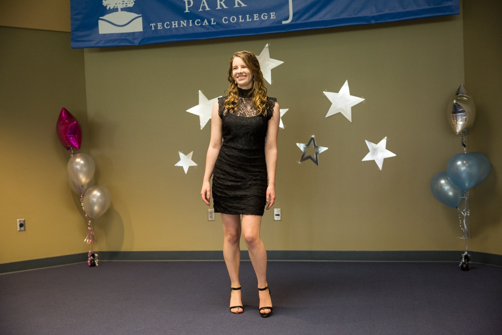 Female in short black dress posing for the Moraine Park Technical College Cosmetology Fashion Show