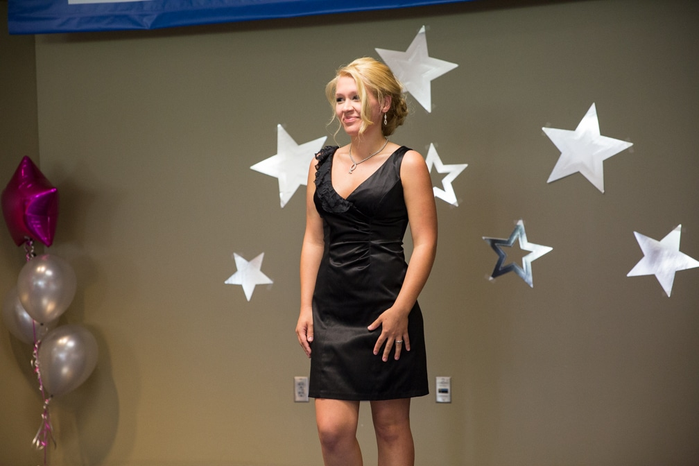 Female in short black dress posing for Moraine Park Technical College Cosmetology Fashion Show