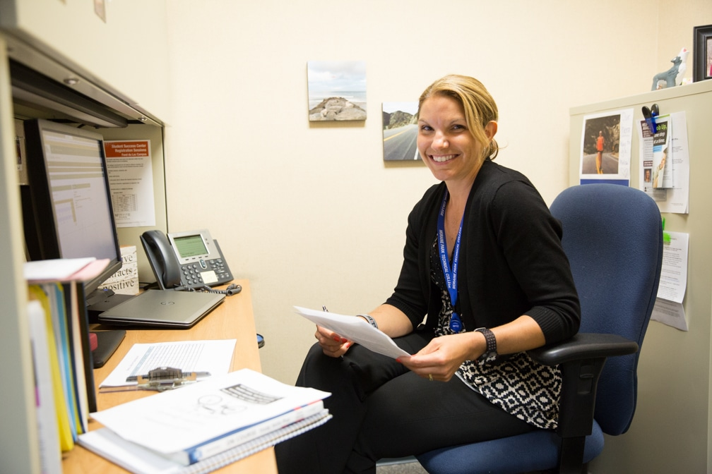 Moraine Park Transition Specialist Melissa Schmidt working at her desk
