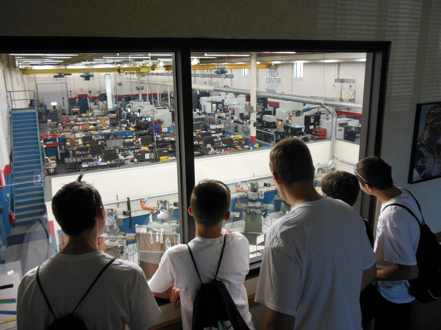 Kids from the Moraine Park Technical College Toolin' It Manufacturing Camp viewing manufacturing work being done