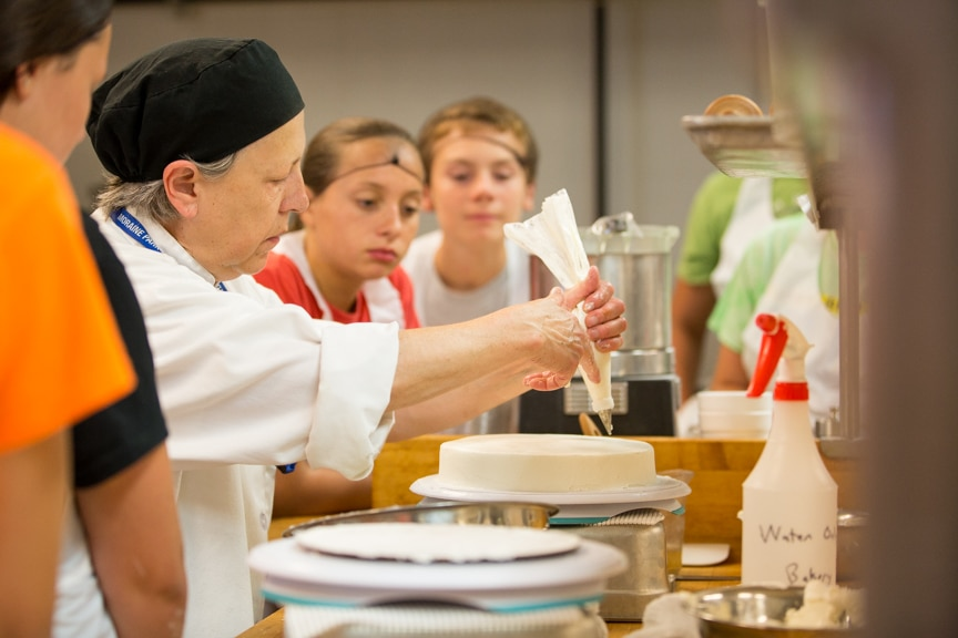 Culinary Instructor Susan Horvath demonstrating cake decorating