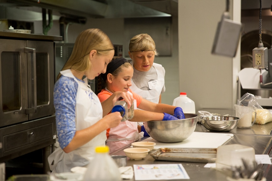 Three girls baking in Tech Knowledge College event at Moraine Park