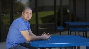 Male Moraine Park student sitting at picnic table