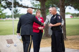 Officer shaking hands with Steve Pepper at 9-11 Memorial Rededication
