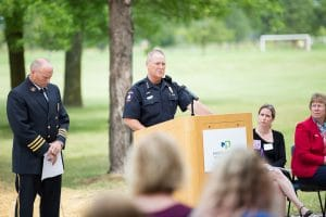 Two officer speaking at 9-11 Memorial Rededication ceremony