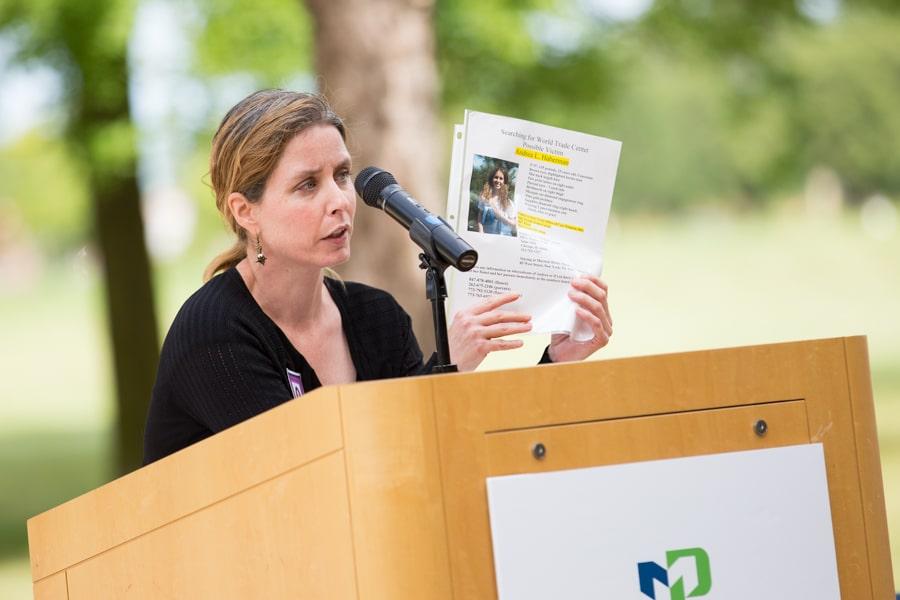 Woman speaking at 9-11 Memorial Rededication