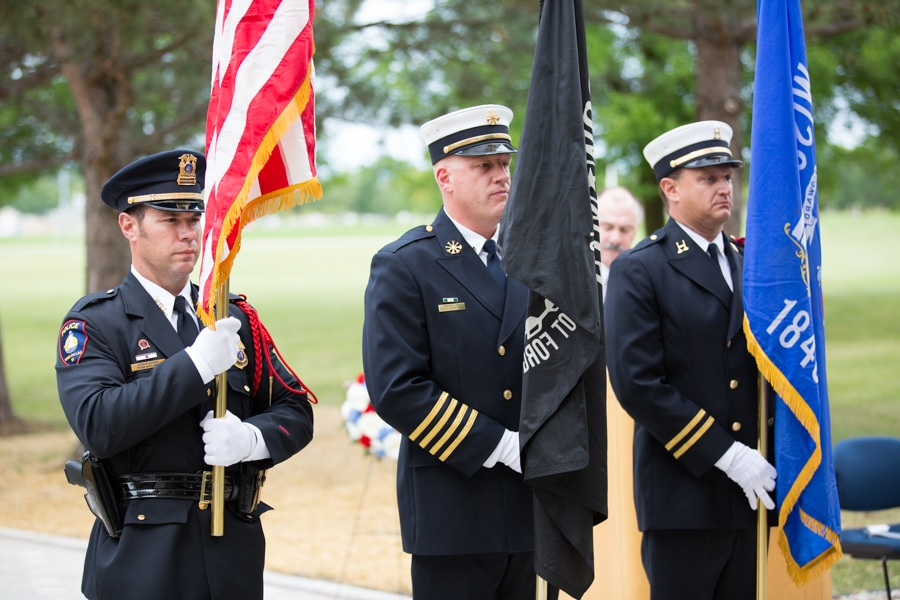 Three male officers holding flags at 9-11 Memorial Rededication at Moraine Park