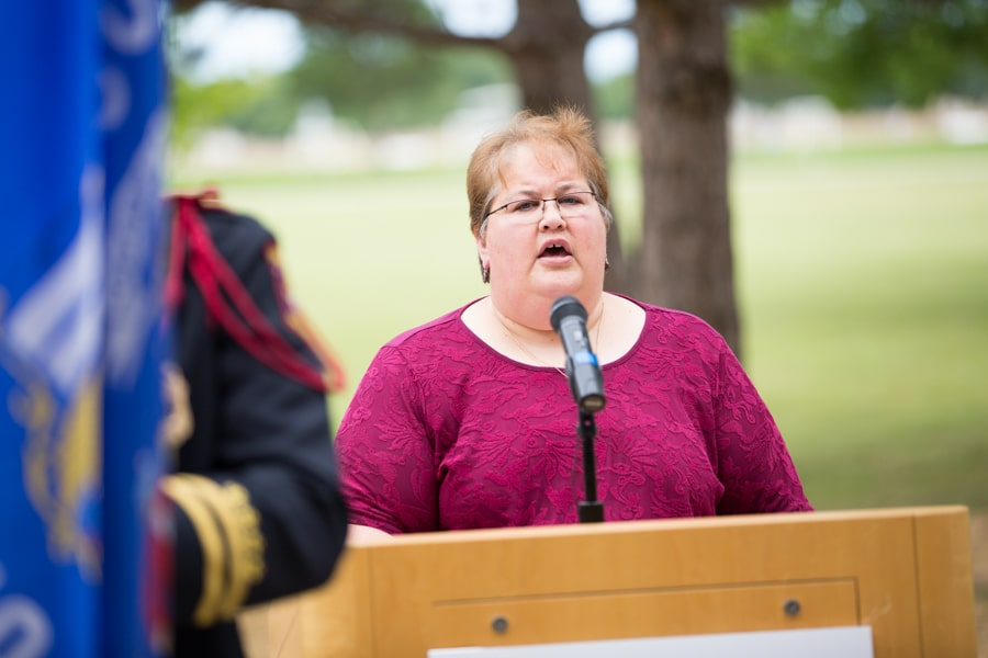 Mary Hoffman singing anthem at 9-11 Memorial Rededication at Moraine Park