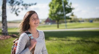 Female Moraine Park student outside with backpack