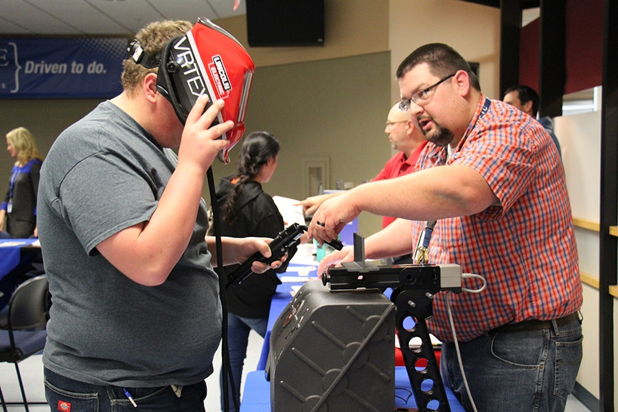Attendee uses the virtual welder at the MPTC Career Showcase