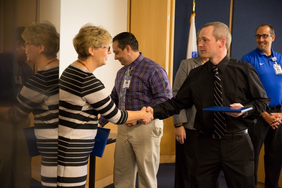 Anne Lemke shaking hands at TACT 3 conference
