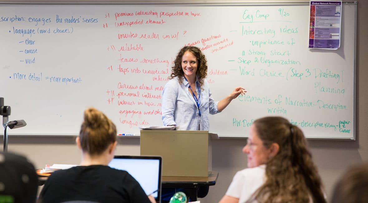 Moraine Park Instructor Emily Hayes teaching students notes on white board