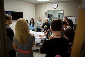 middle school students tour moraine park nursing lab