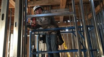 Apprentice working of steel framing at Moraine Park