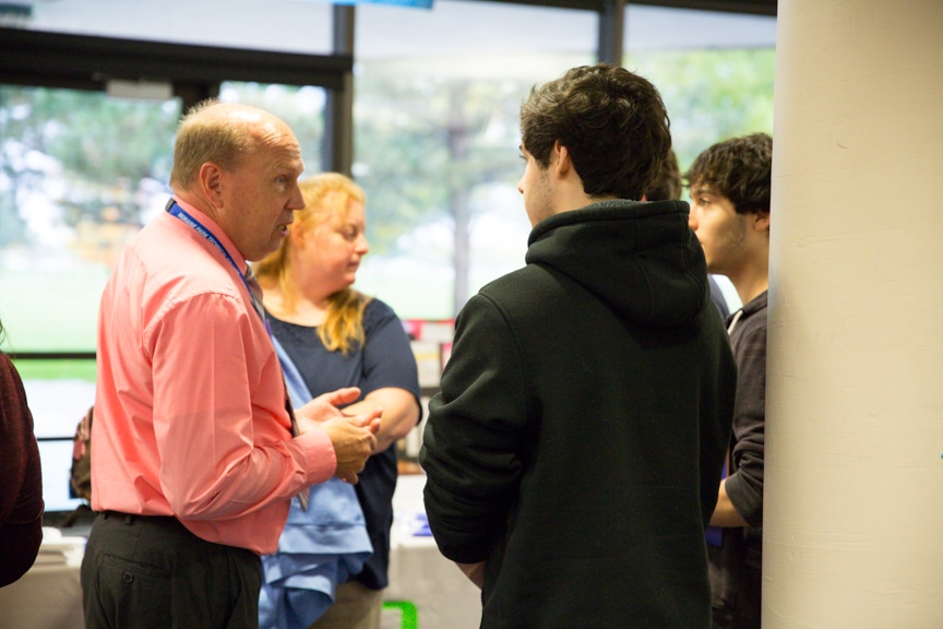 guests speaking with staff at career showcase