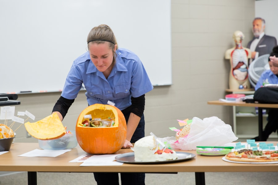 female student by pumpkin with human cell labels and descriptions