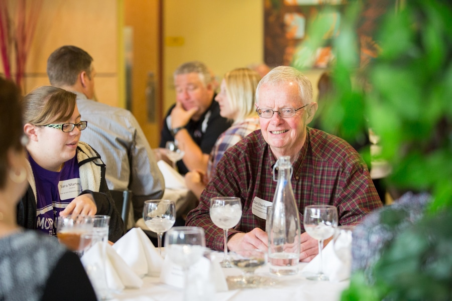 man sits at table during moraine park scholarship banquet