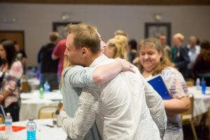 oraine Park Fall leadership conference students hugging