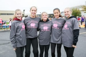 group stands in moraine park pink pumpkin shirts
