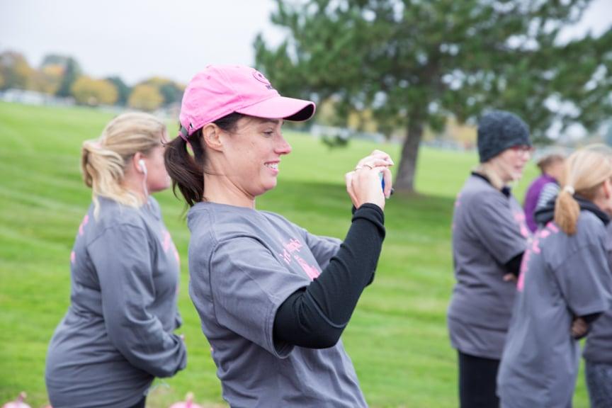 staff member takes photos at moraine park pink pumpkin run