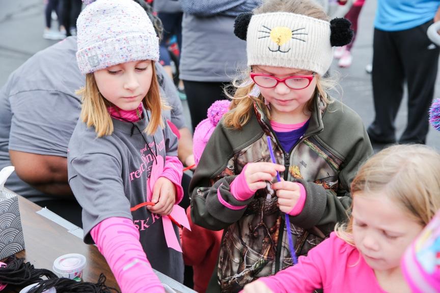 children doing craft activity at pink pumpkin event