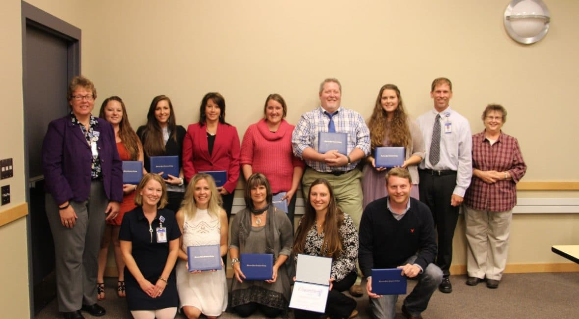 medica assistant group stands with diplomas