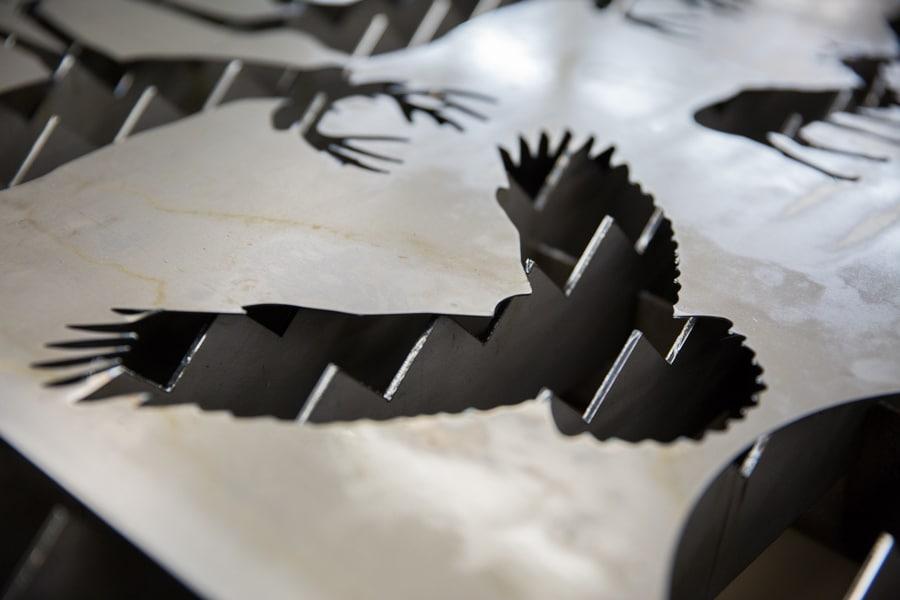 cutouts of metal fabrication project shaped like eagle