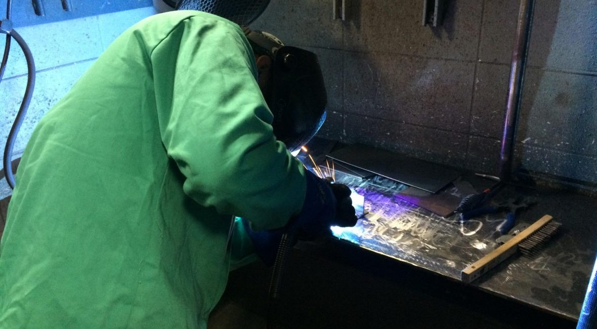 Welding student welding in the lab