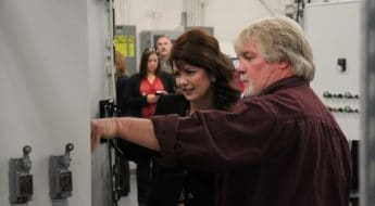 DeWayne Sexton Moraine Park student demonstrating machinery to Rebecca Kleefish