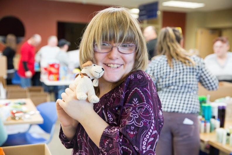 girl hugging a stuffed dog