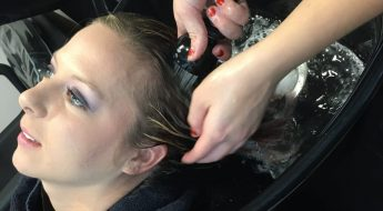 Moraine Park Social Media & Advertising Manager, Carol Moore getting hair washed in Cosmetology