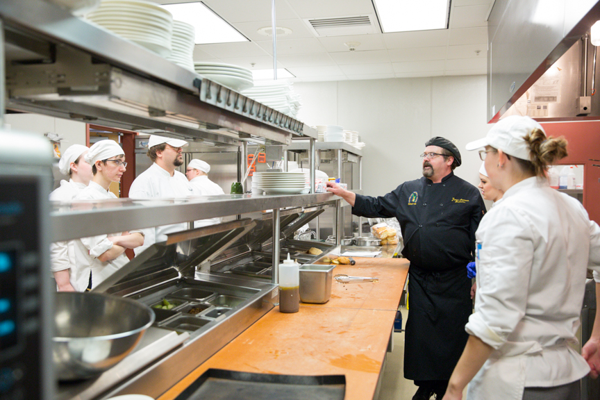 Moraine Park culinary student preparing food in kitchen