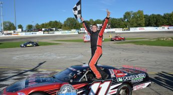Kulwicki race car driver holding winning flag