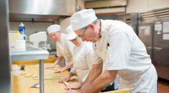 Moraine Park Culinary instructor Tom Endejan demonstrating rolling dough