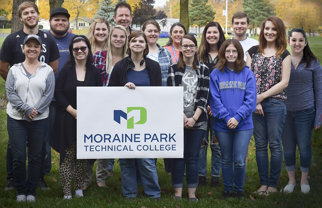 """Group photo of Moraine Park students helping with """"Humans of Oshkosh"""" book"""