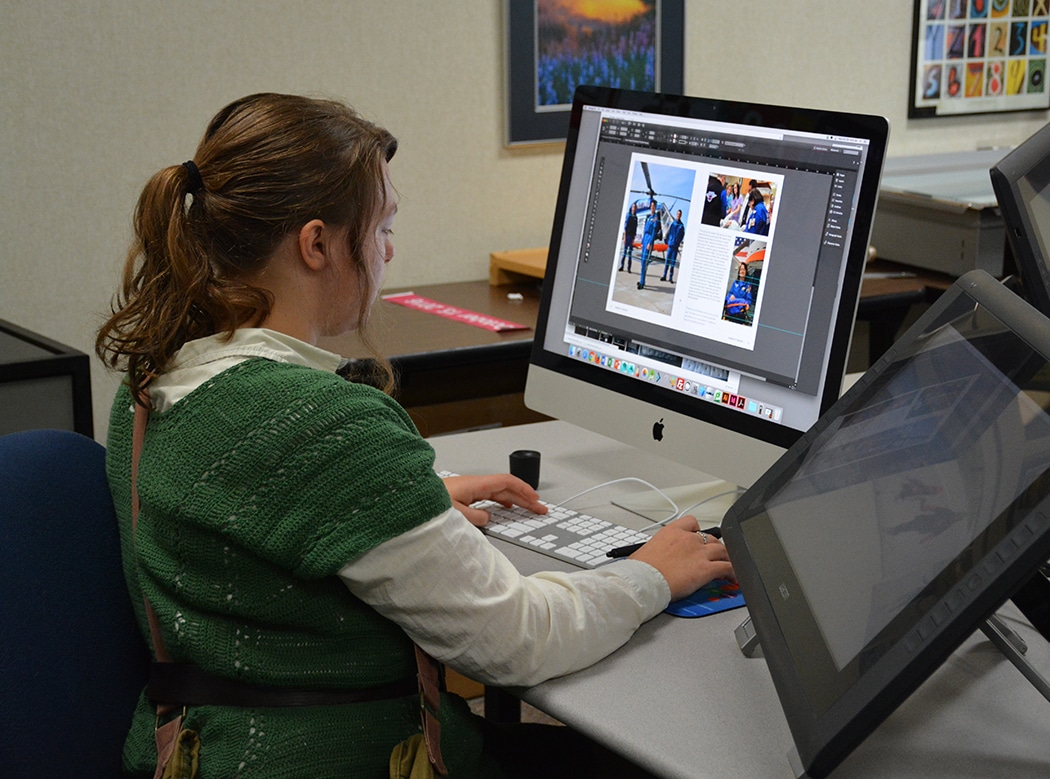 "Moraine Park female student creating page for ""Humans of Oshkosh"" book"