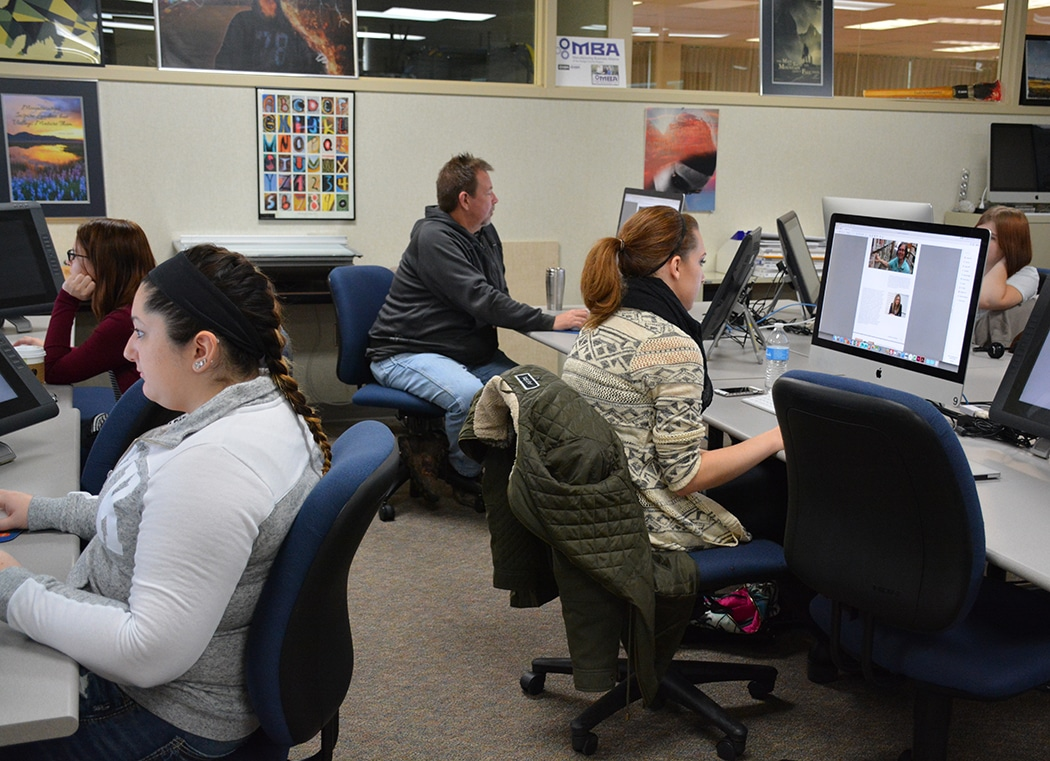 """Moraine Park students working on computer to create """"Humans of Oshkosh"""" book"""