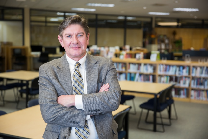 Moraine Park EWD Representative, Doug Holmes in library