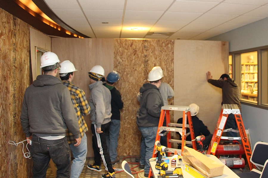 Moraine Park Construction students assembling a wall