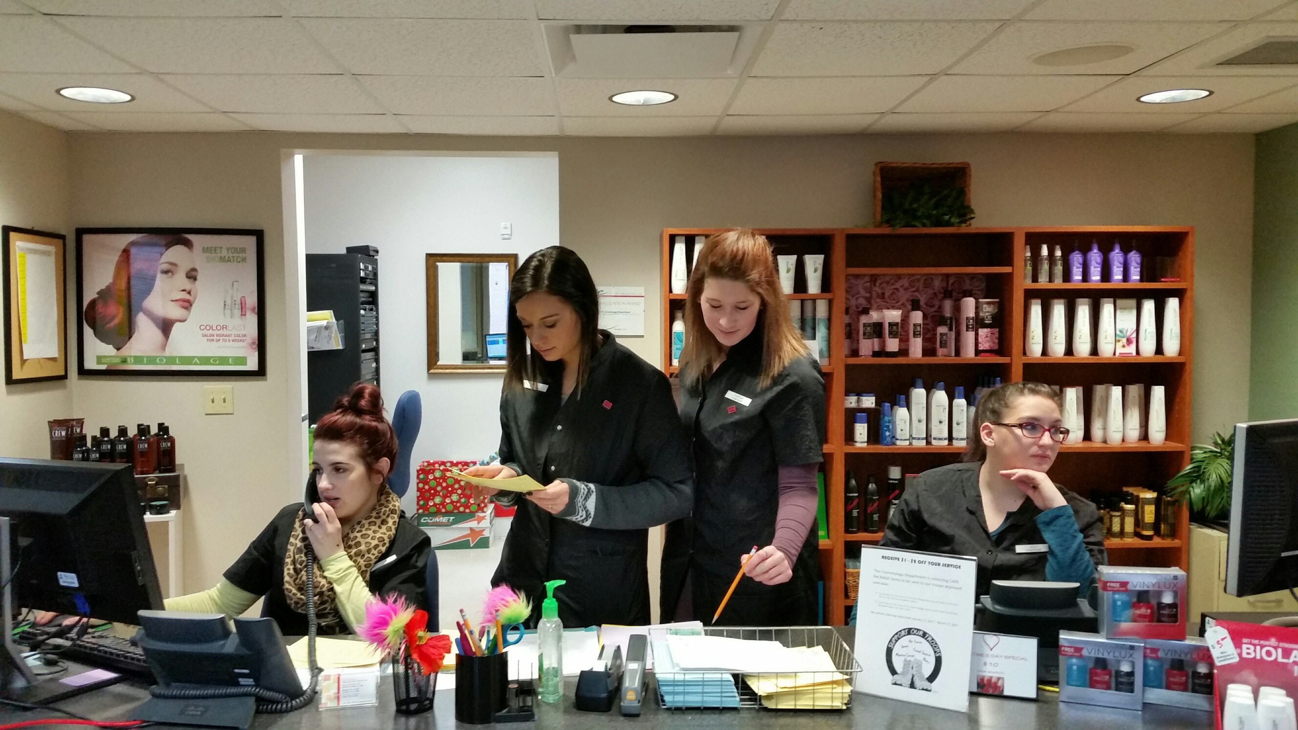 Four female Cosmetology students behind counter
